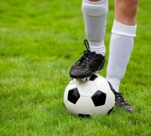 6144384-soccer-player-and-soccerball-on-the-field