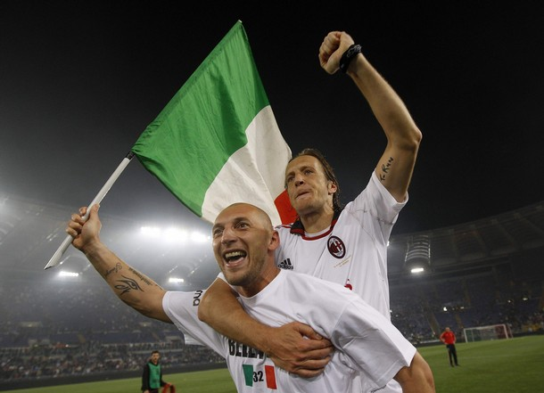 AC Milan's Abbiati and Ambrosini celebrate after winning the Italian Serie A title in Rome