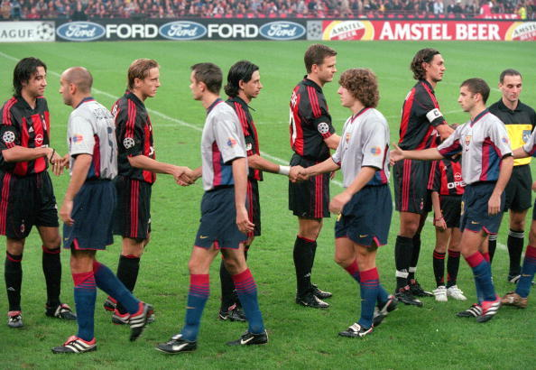 18 Oct 2000:  Barcelona and AC Milan shake hands before the UEFA Champions League match at the San Siro in Milan, Italy.  The match was drawn 3-3.  Mandatory Credit: Clive Brunskill /Allsport