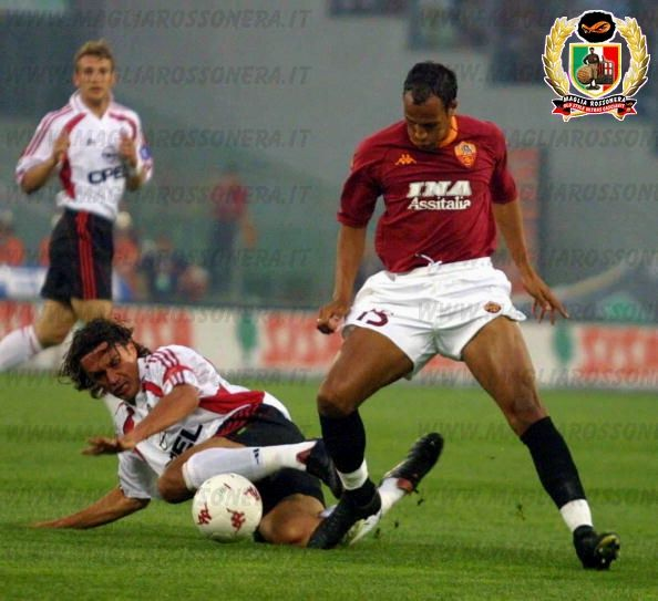 27 May 2001: Zebina of Roma is tackled by Paolo Maldini of Milan during the AS Roma v AC Milan Serie A match played at the Olympic Stadium in Rome. Mandatory Credit: Grazia Neri/ALLSPORT