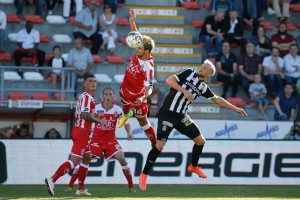 MOUSCRON, BELGIUM - AUGUST 06 : Stefan Simic defender of Royal Excel Mouscron and David Pollet forward of Sporting Charleroi pictured during the Jupiler Pro League match between Royal Excel Mouscron and Sporting Charleroi on the Canonnier stadium , in Mouscron, 06/08/2016 (Photo by Jimmy Bolcina /Photonews via Getty Images)