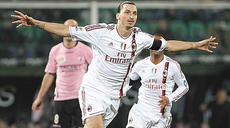 AC Milan's Zlatan Ibrahimovic celebrates after scoring against Palermo during their Italian Serie A soccer match at the Renzo Barbera stadium in Palermo March 3, 2012. REUTERS/Tony Gentile (ITALY - Tags: SPORT SOCCER)
